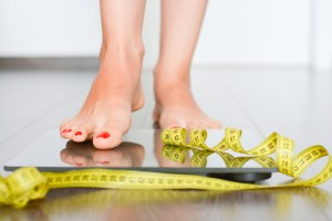 woman's feet standing on weight scale