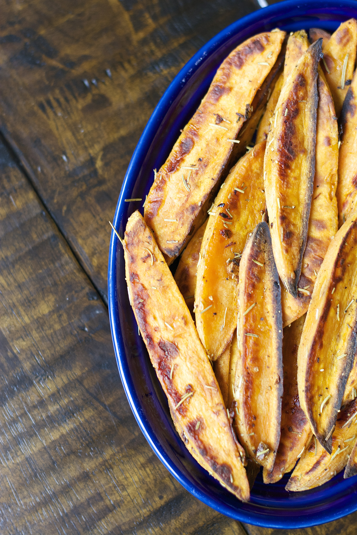 oven baked sweet potato wedges in a blue dish