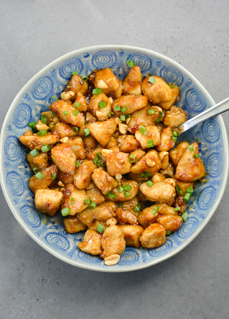 My easy Spicy Kung Pao Chicken recipe is way better than take out, and completely gluten free! Your family will love this flavorful kung pao chicken.