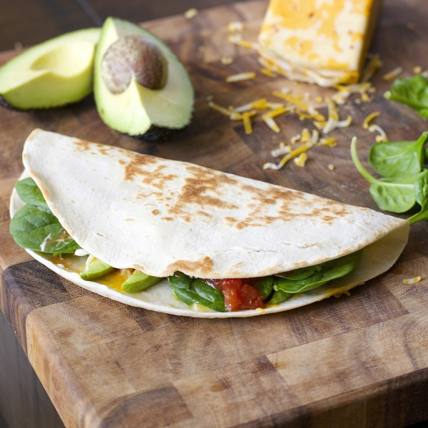 This Spicy Spinach and Avocado Quesadilla is a simple six ingredient meal! A healthy, hearty dinner perfect for busy nights!