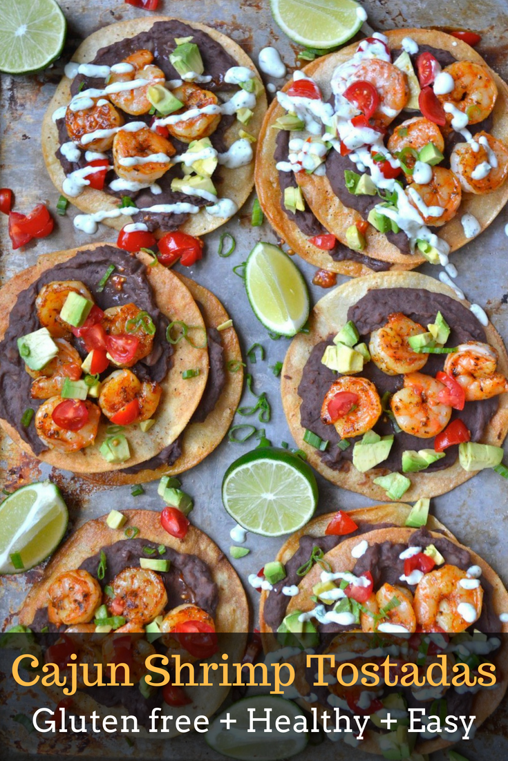 These easy Cajun Shrimp Tostadas are full of zesty shrimp, refried black beans, fresh veggies and a delicious jalapeño ranch sauce! Ready in just 30 minutes and perfect for busy weeknights!