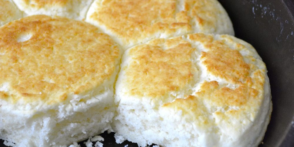 PERFECT Gluten Free Buttermilk Biscuits! These light and fluffy gluten free biscuits are loaded with buttery flavor! You'd never guess they are gluten free!