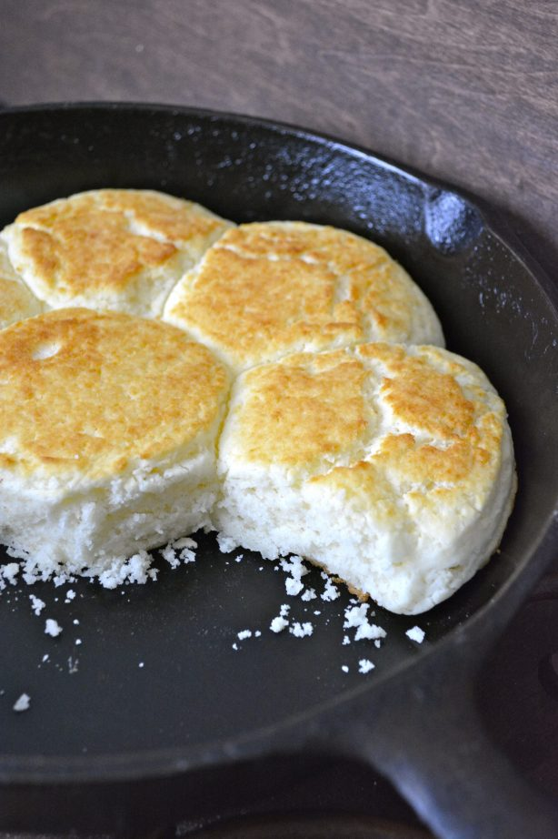 four bisquick buttermilk biscuits in a cast iron skillet