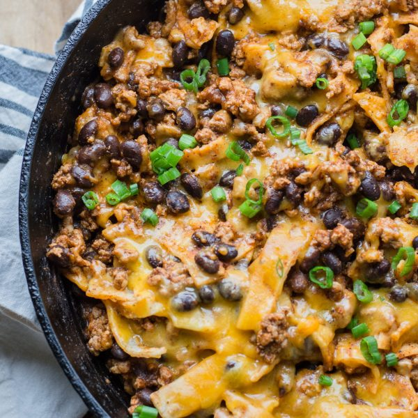 This super easy One Pan Enchilada dish will become a family favorite! Ground beef, black beans, a flavorful enchilada sauce, tortillas and cheese come together for a simple one pan, 20 minute meal!