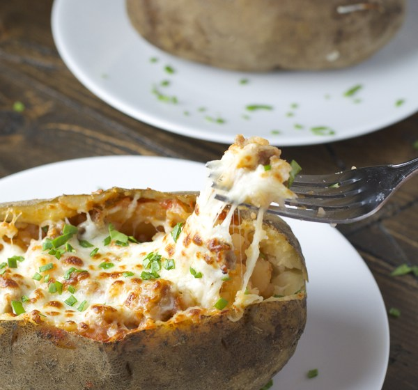 Pizza Stuffed Baked Potato! Everything you love about pizza stuffed in a perfect baked potato!
