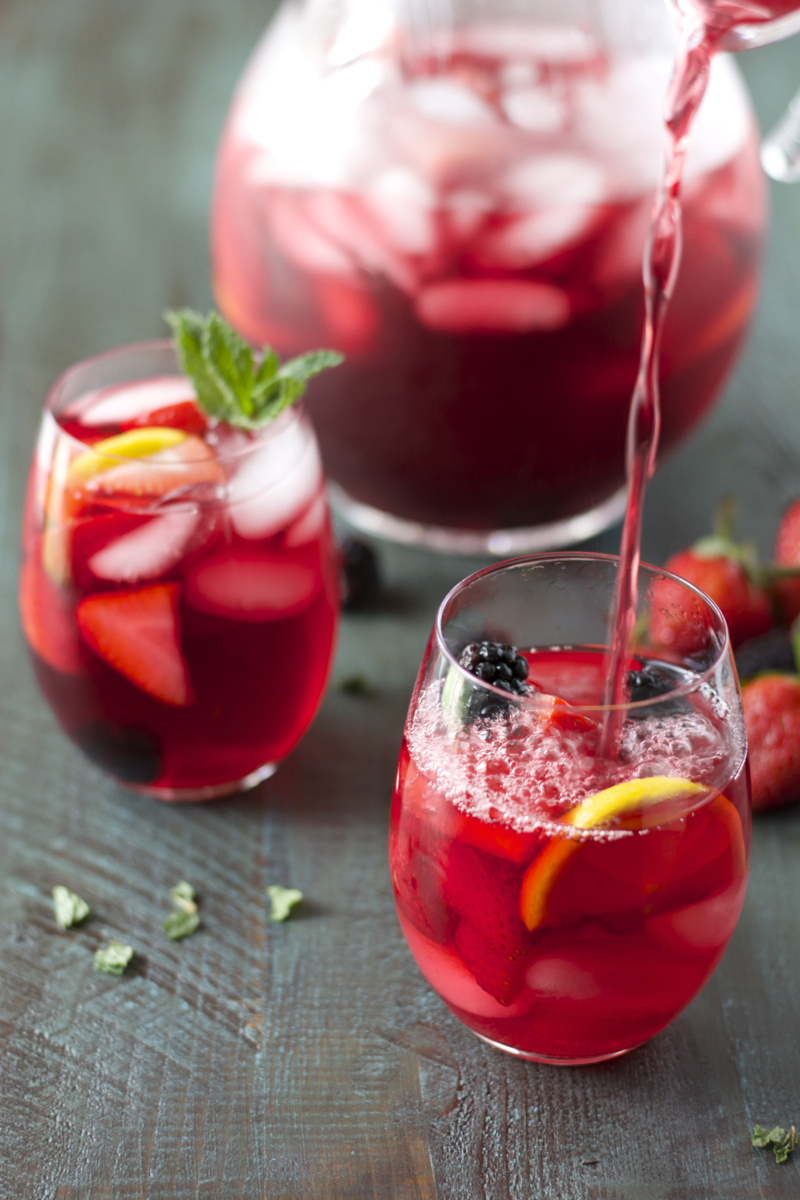 Passion Fruit Tea packed with fresh lemon, berries and mint! Super refreshing!