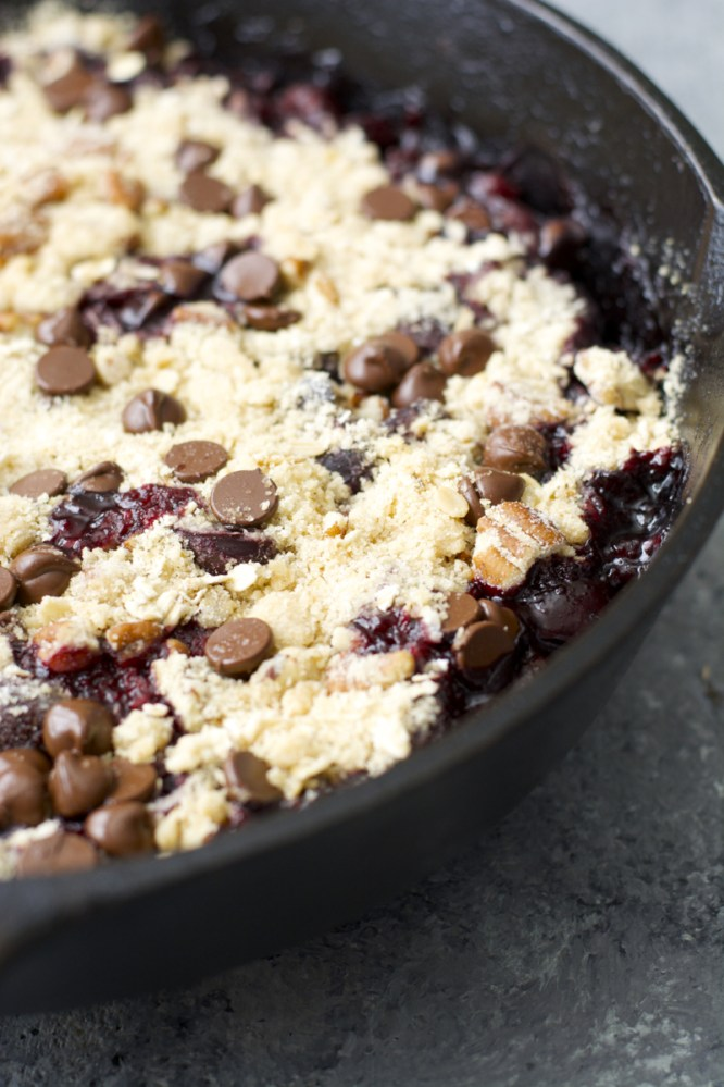 This Chocolate Covered Cherry Crisp is the ultimate Summer treat! Fresh cherries are topped with an chocolate chip oatmeal cookie crumb topping!
