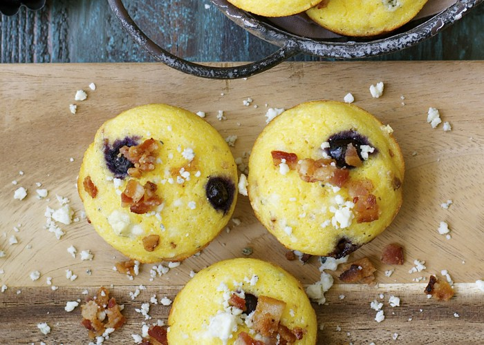 Buttery corn muffins are packed with sweet blueberries, salty bacon and tangy gorgonzola cheese for a delicious and unexpected side dish!