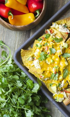 Crispy nachos are topped with fresh avocado, sweet peppers, tuna and lime juice! These healthy and easy Loaded Tex Mex Tuna Nachos are the perfect easy weeknight meal!