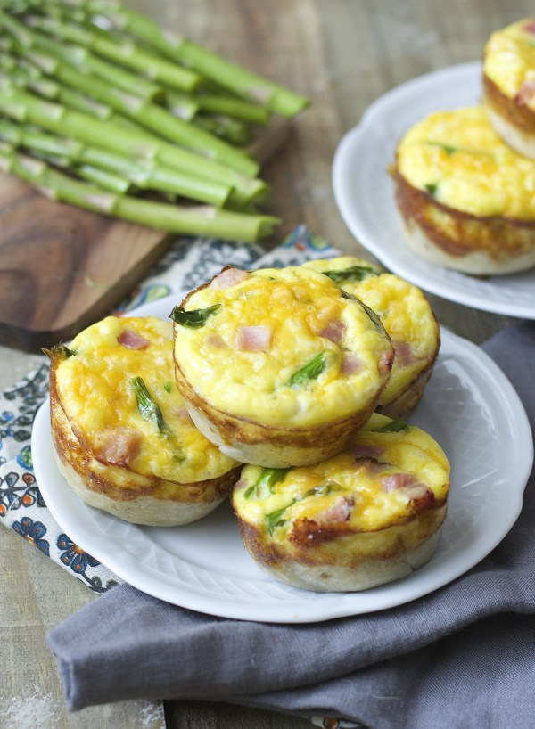Mini Quiche cups are packed with tender ham, fresh asparagus and sharp cheddar cheese for a easy Spring brunch!