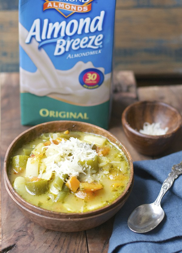 This simple five ingredient Creamy Pesto Veggie and Orzo Soup is vegan, gluten free and ready in under 20 minutes!