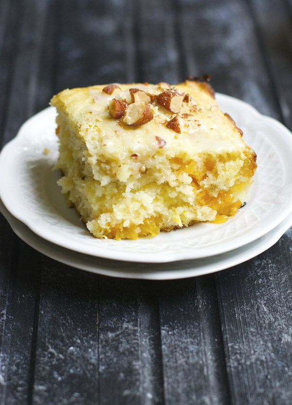 Soft and fluffy orange coffee cake is packed with creamy Almondmilk and a layer of crushed pineapple and vanilla bean!