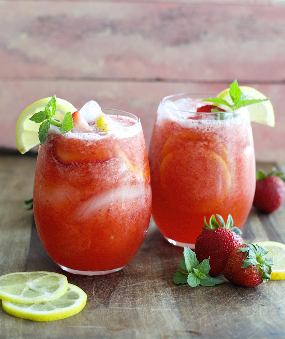 two glasses of blended strawberry lemonade