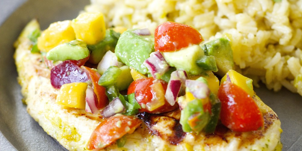 This Sweet and Spicy Habanero Chicken with Mango Salsa is grilled to perfection and packed with flavor!