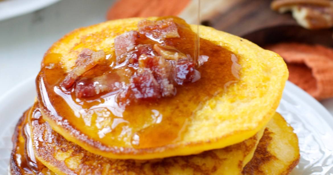 These Sweet Potato Bacon Pancakes are the perfect mix of sweet and savory! Cover with warm maple syrup for an easy holiday breakfast!