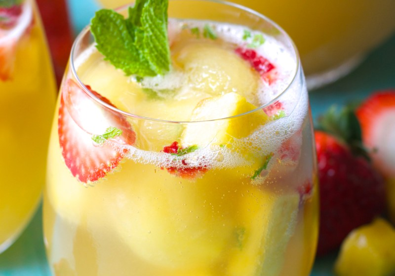 Try this Sparkling Pineapple Strawberry Punch for your next party! Sweet pineapple juice is paired with bubbly ginger ale, fresh fruit and mint for a refreshing non alcoholic punch!