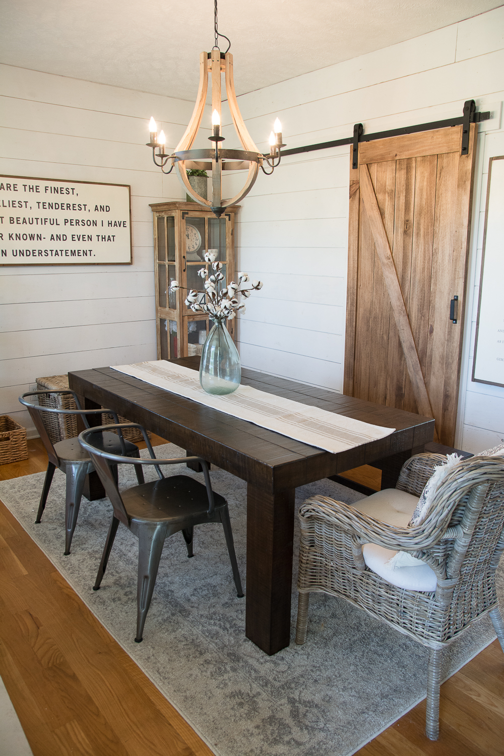 DIY Farmhouse Dining Room! See how we added shiplap walls, a barn door and new lighting to create the perfect #farmhouse look on a budget! And how you can do it too!