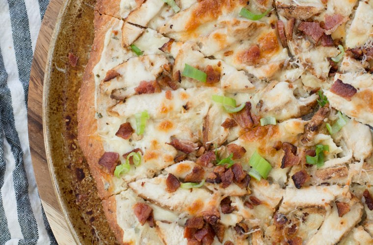 This easy Keto Chicken Bacon Ranch Pizza has a perfectly crispy low carb crust and is loaded with grilled chicken and bacon! Only 3 net carbs per slice!