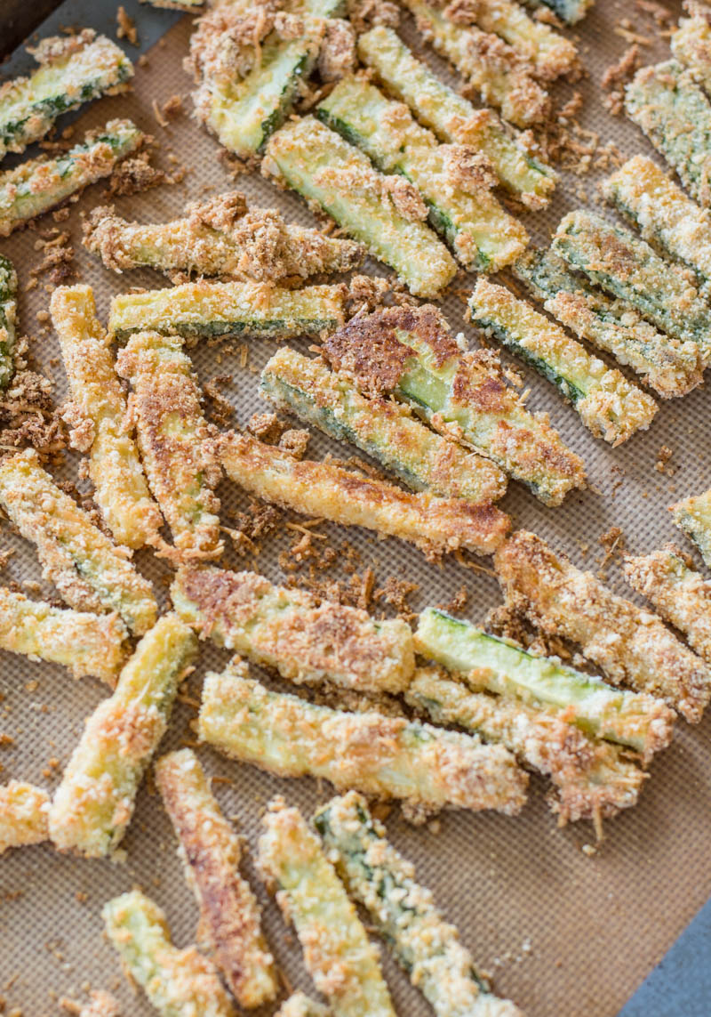 You will love these Keto Zucchini Fries for a low carb side! These fries are breaded with almond flour, parmesan and spices and baked until perfectly crispy! #keto