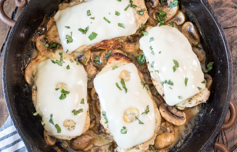 This One Pan Mushroom Chicken is covered in Swiss cheese and swimming in a creamy mushroom sauce! This easy dinner is ready in under 30 minutes and has just 2 net carbs per serving! #keto