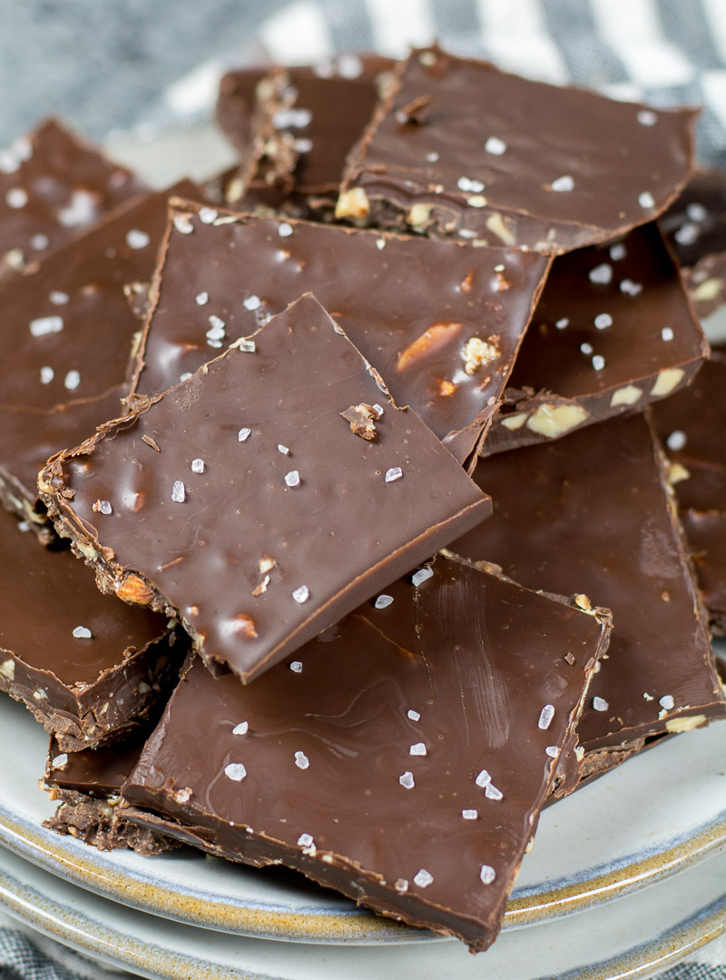 close up of a pile of keto chocolate bark on a white plate