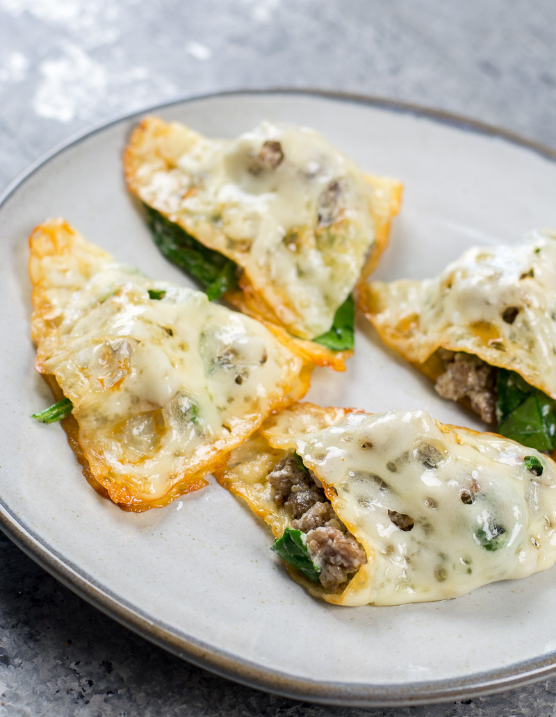 This easy four ingredient Keto Ravioli is loaded with sausage and spinach and only has 1.3 net carbs per serving! #keto