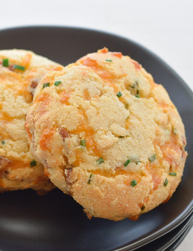 These almond flour Keto Bacon Cheddar Chive Biscuits are exploding with flavor! Packed with sharp cheddar cheese, crispy bacon and fresh chives these biscuits are the perfect low carb side with just 4 net carbs each!