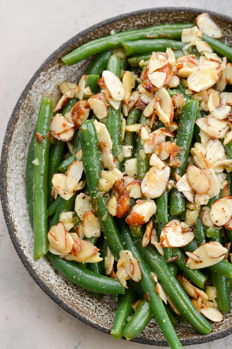 Green Beans Almondine is a classic side dish that goes perfectly with most entrees! Tender green beans are tossed in a rich butter sauce and toasted almonds, for only 3.6 net carbs per serving!