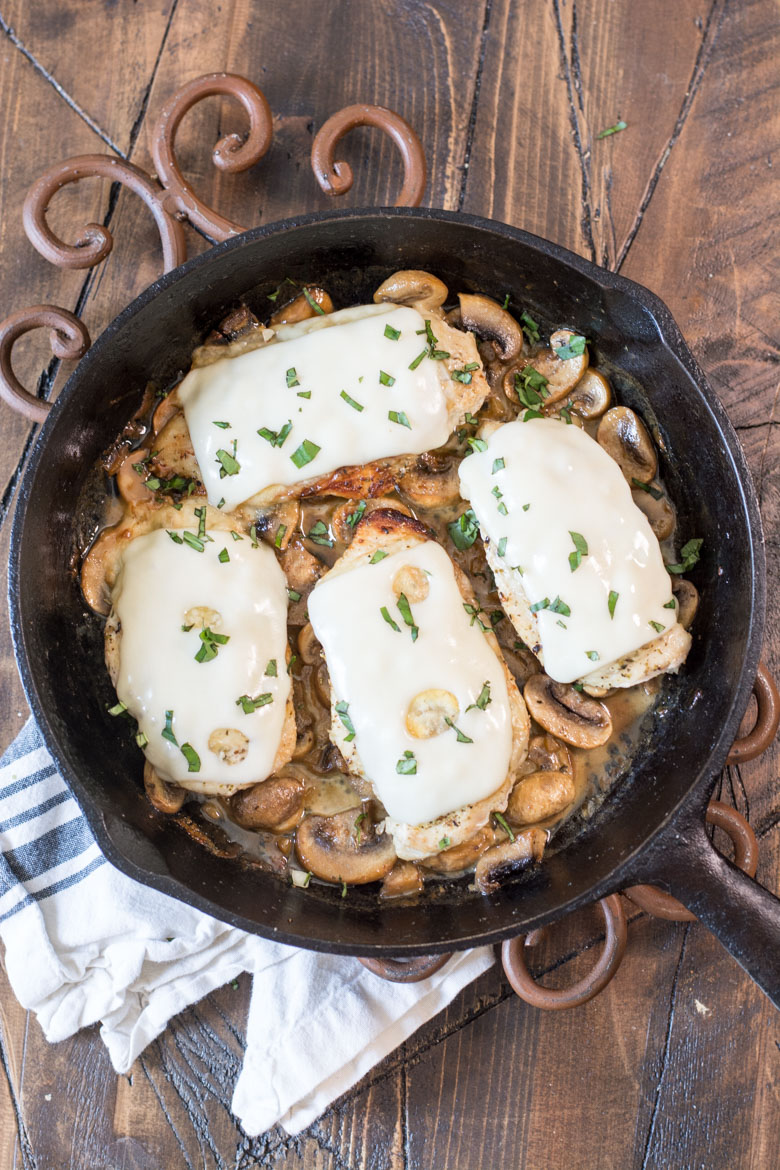 This One-Pan Keto Chicken and Mushroom Skillet is covered in Swiss cheese and swimming in a creamy mushroom sauce! This easy dinner is ready in under 30 minutes and has just 2 net carbs per serving!