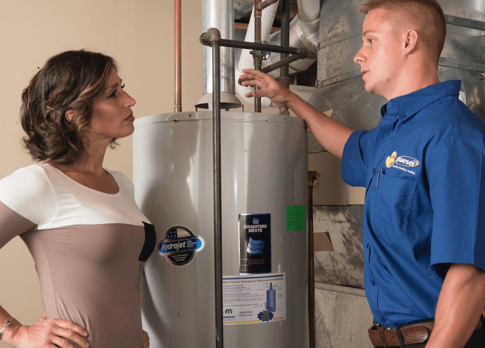Maeser tech explaining to the client about her water heater.