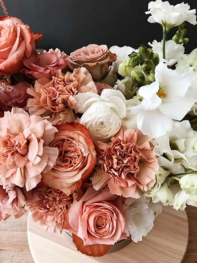 Summery pink and white flowers arranged in a vase