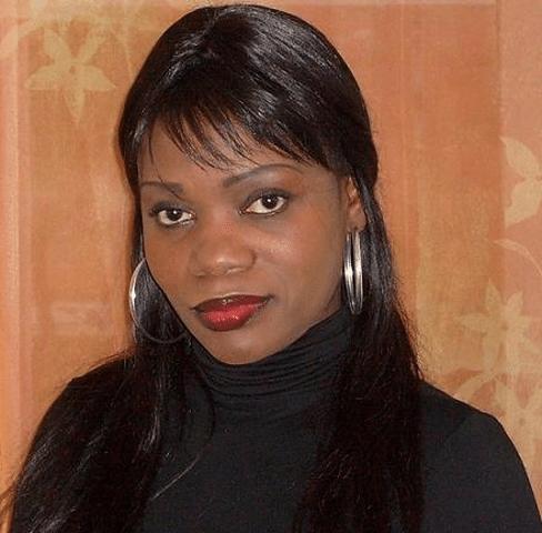 Mme Candide Okeke, leader d'opinion. Résistante-patriote politique congolaise dans la Résistance. «Mpo na kobikisa ekolo Congo ya bankoko». Une image de marque au profit de la RDC.