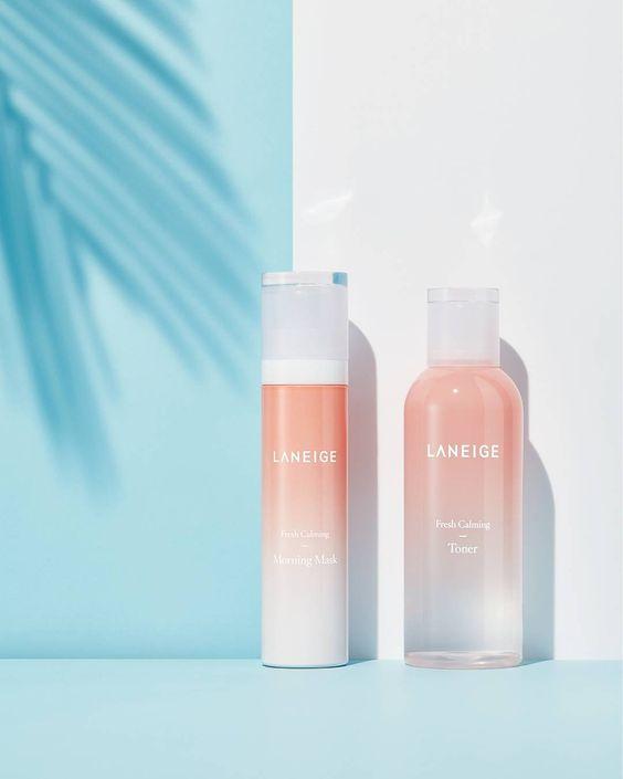 soft coral grandient effect bottles packaging on light blue background