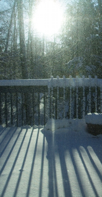 This is our deck on the morning that the thermometer read -32C.  The image is muted by the screen on the window, which was the only window where I dared to open the blind and let the cold air near the glass circulate into the house.