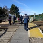 Crossing the unmanned level crossing to Fisherman's Walk