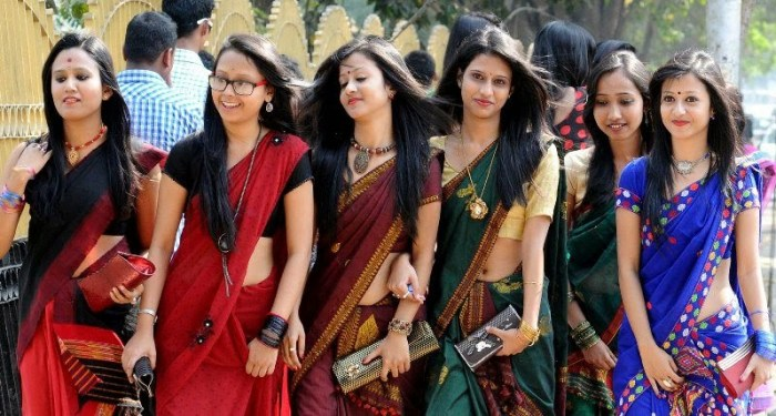 Girls in sarees out on Saraswati Puja. Source ~ magicalassam.com