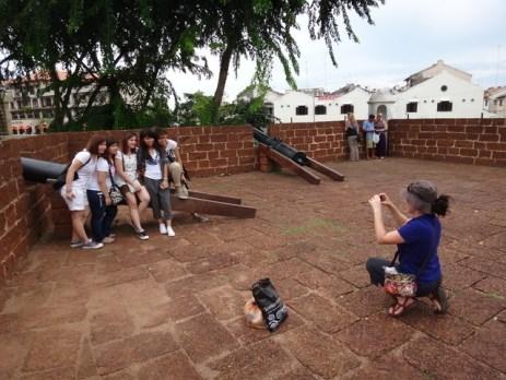 Tanya taking a photo of other tourists Melaka
