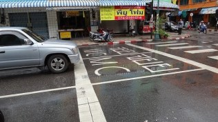 Motorbikes queue up here at the lights in Hat Yai