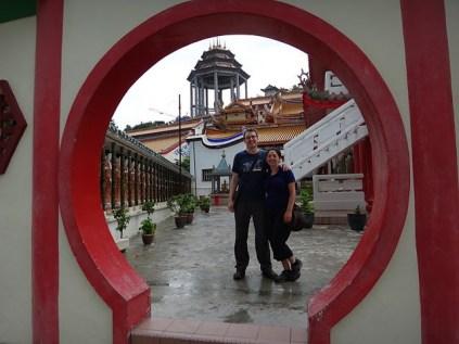 Tanya and Andrew in the archway at Kek Lok Si, Penang