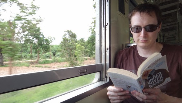 Andrew Reading On The Train From Bangkok to Aranyaprathet