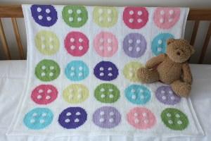 Copertine a maglia per neonati, culle e lettini.