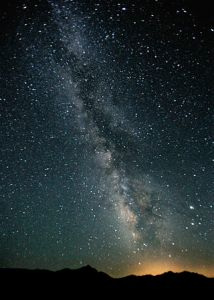 Milky Way in the night sky over Black Rock Desert, Nevada taken on 7/22/2007 by Steve Jurvetson. This photo is licensed under the Creative Commons Attribution 2.0 Generic license. Image available at: https://en.wikipedia.org/wiki/Milky_Way#/media/File:Milky_Way_Night_Sky_Black_Rock_Desert_Nevada.jpg