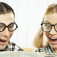 couple reading exciting headline