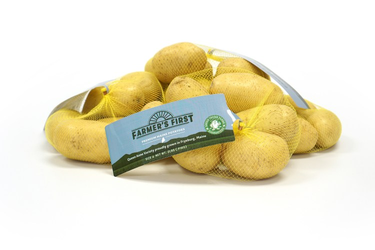 a mesh bag with yellow potatoes in in and a tag that says Farmers First