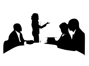 Silhouette of people in meeting