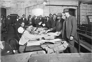 Men at the recruiting office at the Town Hall,...
