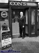Street-side presence: Manager Willie Buckley about to open the doors to Castleisland's new dining experience on Thursday evening. ©Photograph: John Reidy