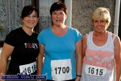 Catherine McCarthy, Castleisland (left) pictured with: Marguerite Howard and Mary Breen, Currow at the start of An Riocht AC Couch-to-5K Road Race/Fun Run in Castleisland on Friday evening. ©Photograph: John Reidy