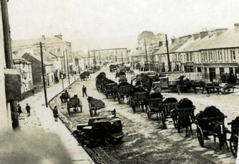 An everyday scene at Upper Main Street, Castleisland in 1942 as horse-drawn rails of turf head for the railway during 'The Emergency' years. Photograph: Danny Sheehy July 24th 1942