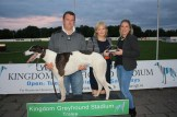 Aileen Lynch of Lynch's pharmacy presents owner of 'Dromore Premier' Declan Murphy and Ann Marie Murphy with the trophy.